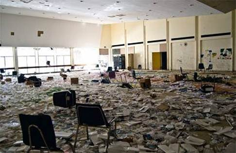 A ruined Detroit school room with trash everywhere